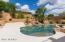 View of kiva fireplace with sitting area, and pool / spa / waterfall.