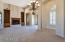 16 foot ceilings and tall windows add to the stately feel of the Living and Formal Dining Rooms.