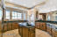 Welcome home to your gourmet kitchen featuring Alder cabinets, granite counters including an island with extra sink