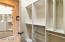 The master bedroom has two spacious walk-in closets