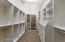 The walk-in closets have built in shelving and drawers