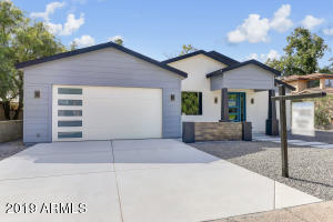 Great curb appeal on this home. The wide garage is a nice feature for your car doors!