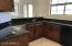 Need more cabinet and counter space? There is plenty more for you in this wet bar area.
