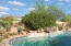 Custom free form heated pool and spa surrounded with multiple terraces and embracing McDowell Mountain views.