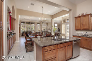Spacious Gourmet Kitchen overlooks expansive great room, allowing you to interact with guests while preparing meals