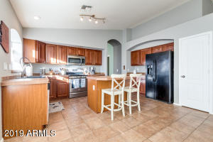 Kitchen with island and tile flooring