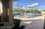 Salt water Pool and Spa with fire feature in Pool seating area. Sheer descent water features and expansive sunning deck.