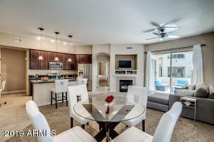Great room, dining, kitchen. Open floor plan. 9+ high ceilings. Feels like a custom home.