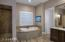 Deluxe spaces for relaxation in the Master Bathroom.