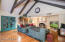 Family room vaulted ceilings with wood beams.