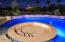 Uniquely designed conversation area with fire feature is set in the Pool for enjoying cool Arizona evenings under the stars.