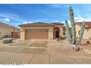 This lovely home is on a North/South facing lot in the 55+ guard gated resort of Arizona Traditions.