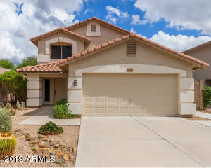 Great curb appeal with easy to maintain front desert landscaping.