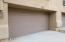 Deep garage with direct access into laundry room and kitchen