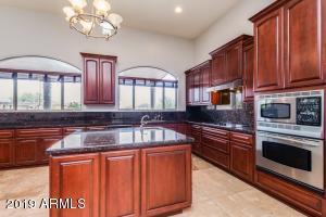 Premium cabinets, back yard view windows