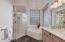 Large walk-in shower and soaking tub.