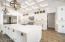 This stunning kitchen is a chef's dream! Top of the line Thermador appliances including a refrigerator, freezer and wine cooler. The Thermador oven/range includes a built in skillet. There is a pot filler above the stove as well.