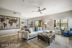 Open concept family room blends with with dining room & patio