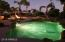 Enjoy the great ambience as the sun is setting in your private backyard with lush landscaping, pool/hot tub and gas fire pit.