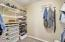 Master closet with built in shelving
