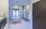 Sleek Modern Cabinetry With Limestone Flooring