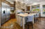 Butcher Block Island With Antique White Cabinetry