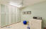 Nice Big Laundry Room with plenty of built-in cabinets for storage