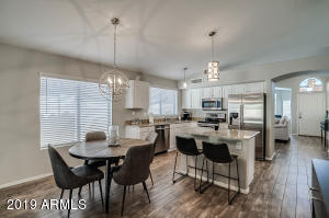 Remodeled kitchen includes all SS appliances. Granite counters, newer lighting, blinds & white cabinets.