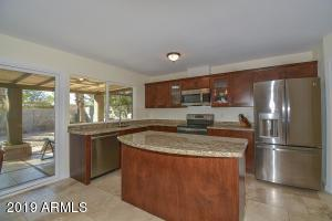 The kitchen was updated in 2018 with all new cabinets, counters, raised ceilings, pantry & vinyl clad windows and slider to the covered back patio.