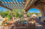 Multiple covered patios, seating and dining areas, outdoor kitchen and heated pool with spa provide plenty of opportunities to enjoy and appreciate the Sonoran Desert lifestyle at its best.