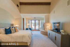 The spacious master suite is the perfect place to retreat to renew one's senses. With private access to the outdoors, cantera fireplace and beamed ceilings, you'll fall in love with the tranquility it offers.