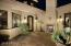 Enter thru this inviting courtyard with fireplace.