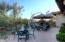 Favorite entertainment area in side yard surrounded by desert.