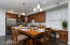 BEAUTIFUL OPEN KITCHEN WITH GRANITE COUNTER TOPS AND STAINLESS STEEL