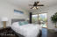 LARGE MASTER BED ROOM WITH INCREDIBLE VIEWS ON THE POOL. WALK OUT PATIO!