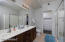 MASTER BATHROOM WITH WALK IN SHOWER, DOUBLE SINKS AND CUSTOM BUILT IN CLOSET DRAWERS/SHELVES