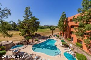 Endless views from your balcony overlooking one of five community pools.