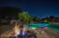 Firepit With Custom Seating, Spa, and Pool With Multiple Water Features