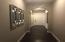 Hallway from Master Bedroom to front of house / garage door.