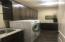 Large laundry room with stainless steel farm sink