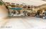 2 1/2 Car Garage with Finished Floor and Overhead Storage Racks and Built-in Cabinets.