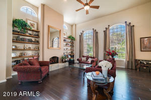 Beautiful, spacious Living Room with wood floors and wood burning fireplace.