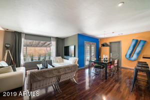 Spacious Living Area Featuring Beautiful Wood Floors, Custom Paint, Recessed Lighting & Designer Wall Treatment.,