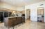 Open kitchen with oversized breakfast bar, walk-in pantry