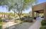 Backyard features pool, spa, BBQ, fireplace, garden, mature desert landscaping
