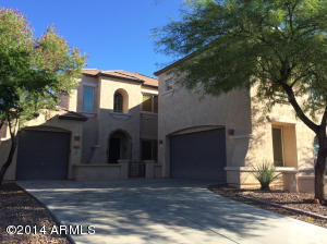 Features a courtyard style entrance with 3 car garage, enclosed courtyard with custom concrete work in courtyard. Low maintenance front.
