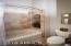 This guest bath has a full tub/shower