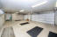Immaculate 3 car garage with built in cabinets
