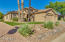 Beautifully manicured Desert front yard with easy-care artificial turf