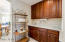 It leads right into the Butlers Pantry. Across this area is a Huge Walk-in Pantry